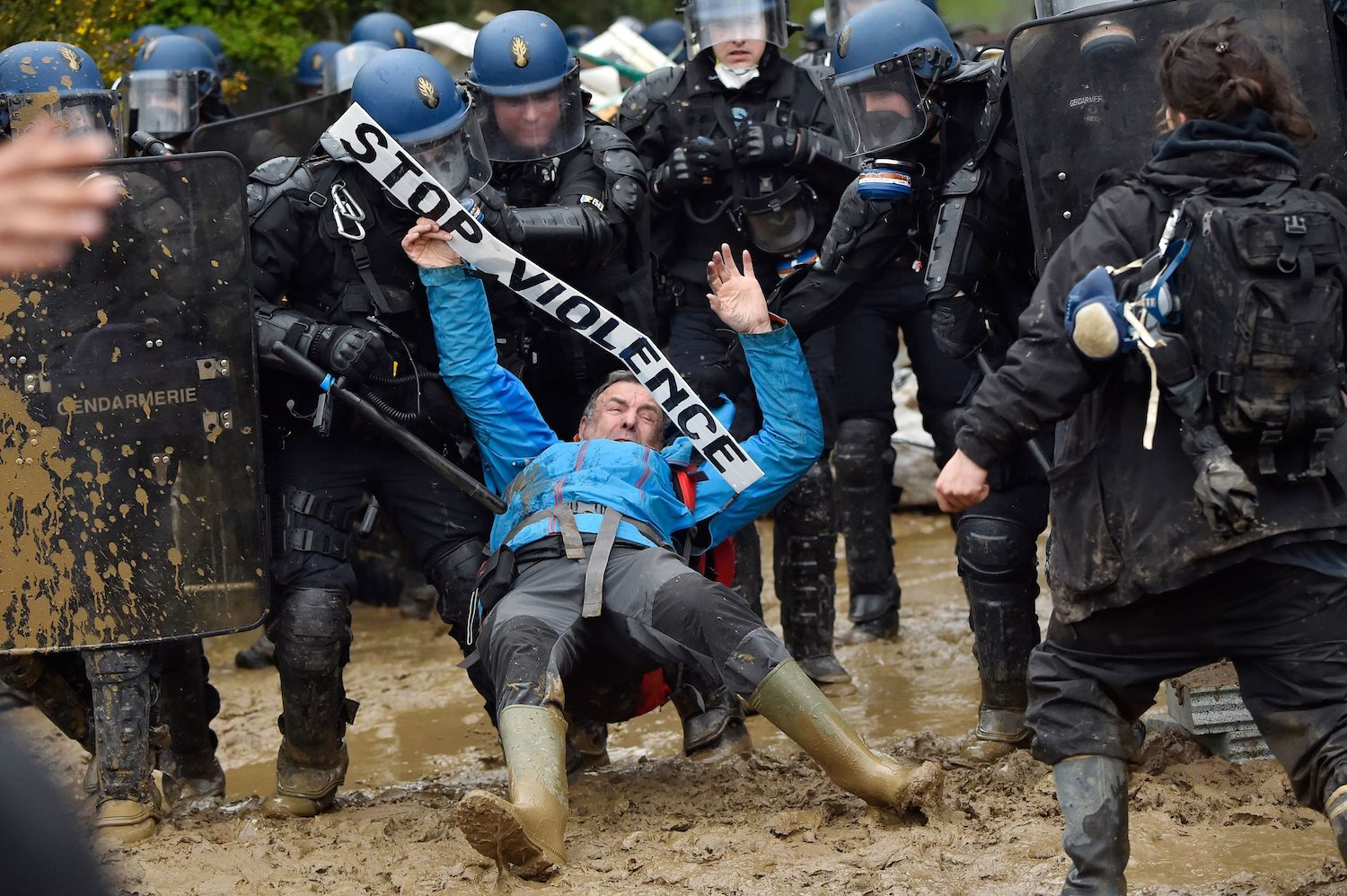 TOPSHOT - French gendarmes charge ZAD activists to clear an area known as ZAD (Zone a Defendre - Zone to defend) of environmental protesters occupying the site of what had been a proposed new airport in Notre dame des Landes on April 9, 2018.    / AFP PHOTO / LOIC VENANCE        (Photo credit should read LOIC VENANCE/AFP/Getty Images)
