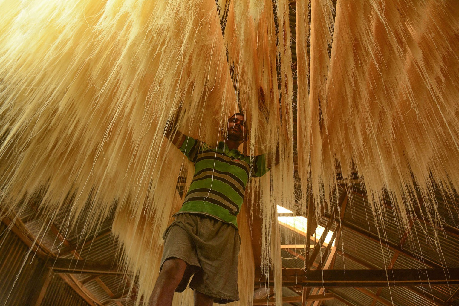 An Indian worker arranges strands of vermicelli noodles to dry inside a factory on the outskirts of Agartala during the Muslim holy fasting month of Ramadan on May 24. The noodles are used in sheer khurma, a sweet Indian pudding sometimes served to break fast during Ramadan. ARINDAM DEY/AFP/Getty Images