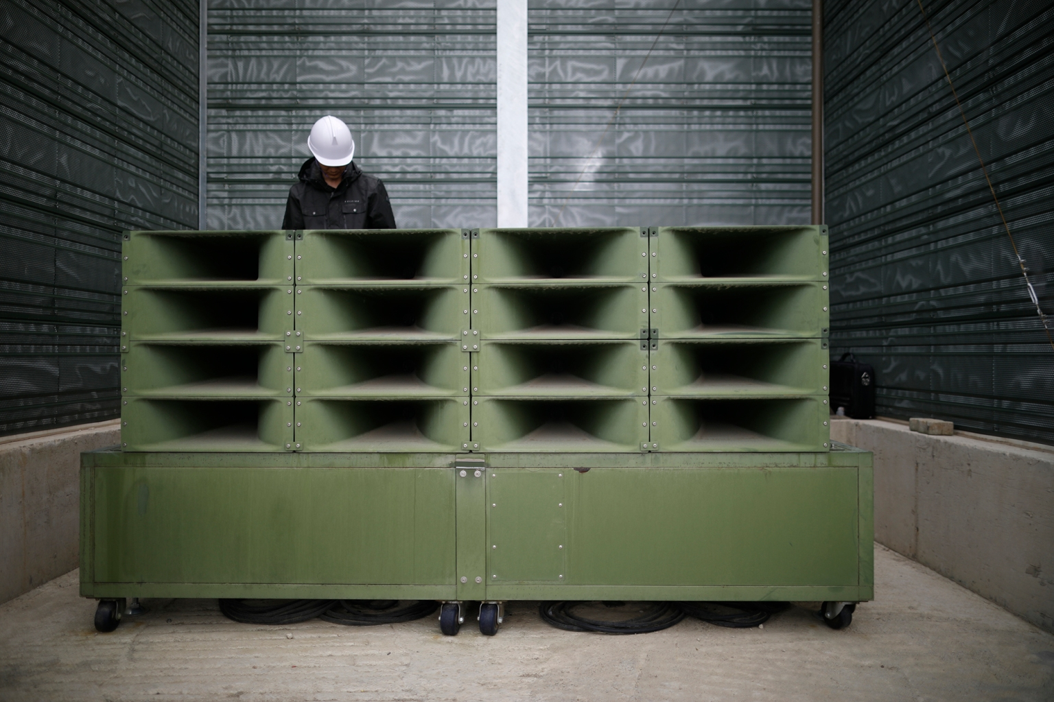 A worker dismantles loudspeakers set up for propaganda broadcasts near the demilitarized zone separating the two Koreas in Paju on May 1. South Korea silenced its battery of giant loudspeakers that blast messages at the North's soldiers in a conciliatory gesture after the historic inter-Korea summit. KIM HONG-JI/AFP/Getty Images