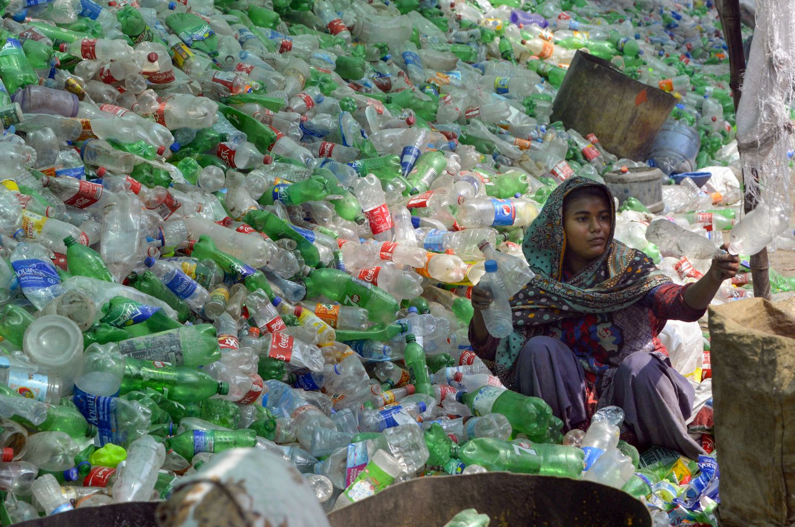 A Pakistani worker sorts plastic bottles at a warehouse in Lahore on May 10. ARIF ALI/AFP/Getty Images
