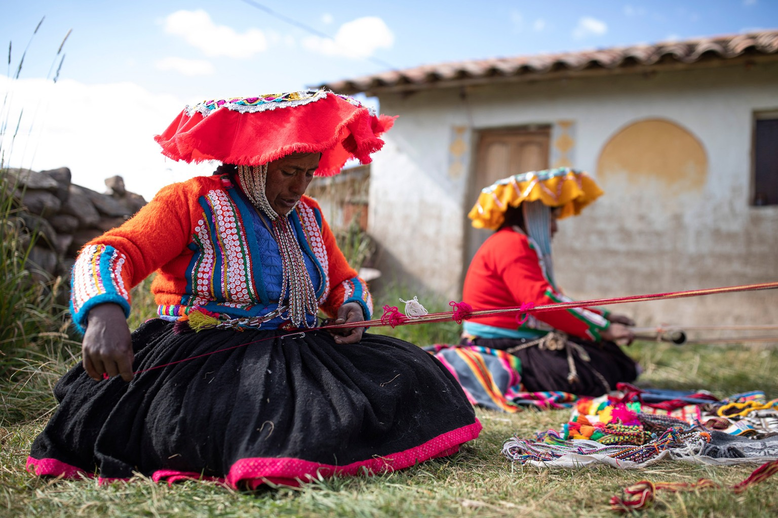 Quechua women weave traditional baskets on May 23 in Tinki, Peru, using methods that go back around 5,000 years. Working with the not-for-profit Threads of Peru, the women — who live in isolated, high-altitude communities — are helped to bring their product to market. Dan Kitwood/Getty Images