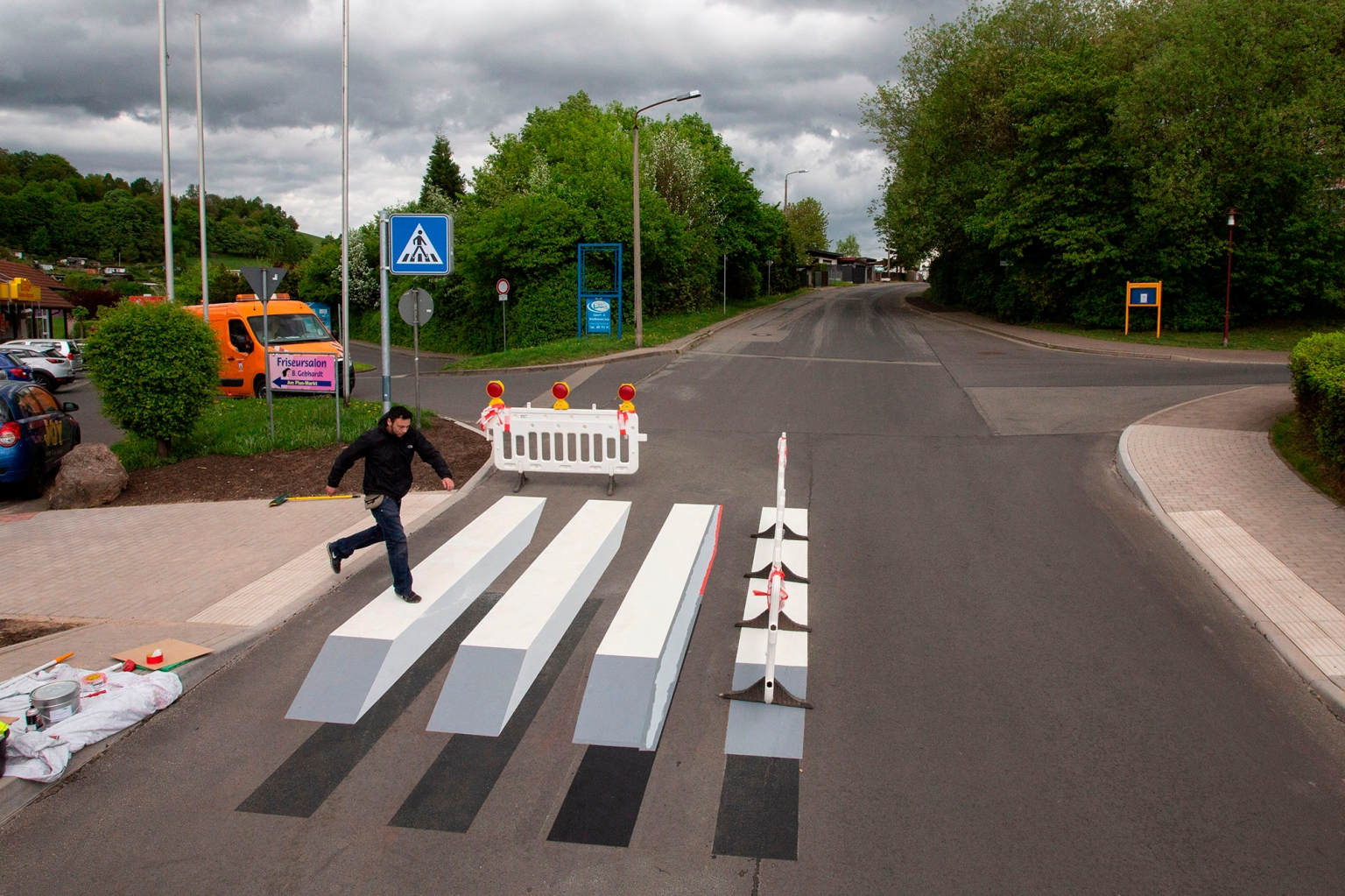 German graffiti artist, Alexander Frank, crosses a 3D painted pedestrian crossing in the town of Schmalkalden, central Germany, on April 30. The artwork is designed to increase road safety. CHRISTOPH SOEDER/AFP/Getty Images