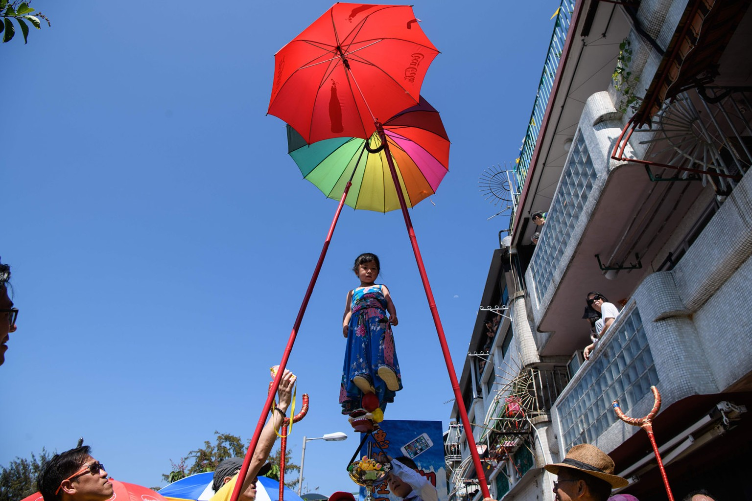 Four-year-old Hazel Kwok stands on a float while portraying former lawmaker Emily Lau during the annual Cheung Chau bun festival parade in Hong Kong on May 22. ANTHONY WALLACE/AFP/Getty Images