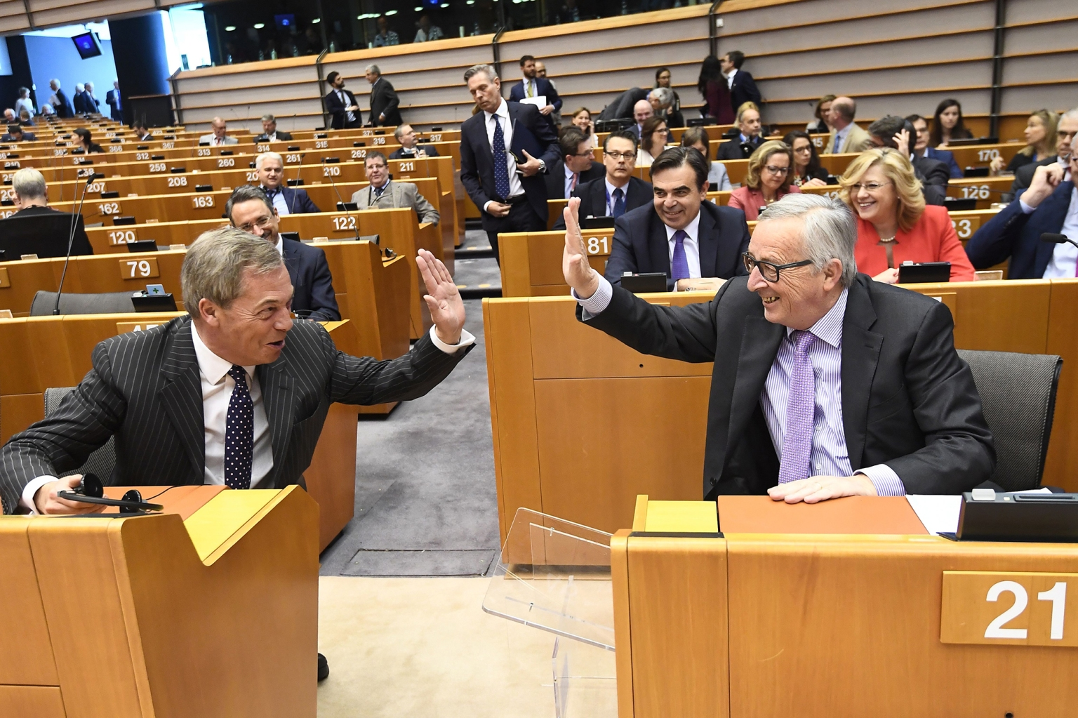 European Commission President Jean-Claude Juncker, right, and Brexit campaigner and member of the European Parliament Nigel Farage exchange a high five at the start of the plenary session on the EU's next long-term budget in the European Parliament in Brussels on May 2. Juncker unveiled plans for a bigger post-Brexit budget worth 1.279 trillion euros covering 2021-2027. EMMANUEL DUNAND/AFP/Getty Images