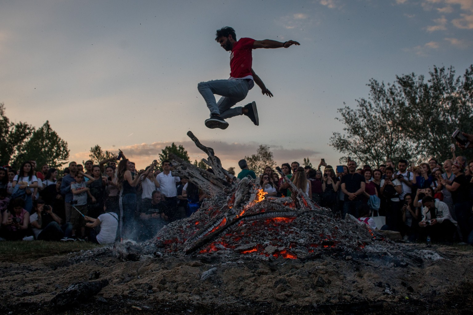 A man jumps over a large bonfire during the Kakava Festival on May 5 in Edirne, Turkey. The festival celebrates the coming of spring among the Roma community.  Chris McGrath/Getty Images