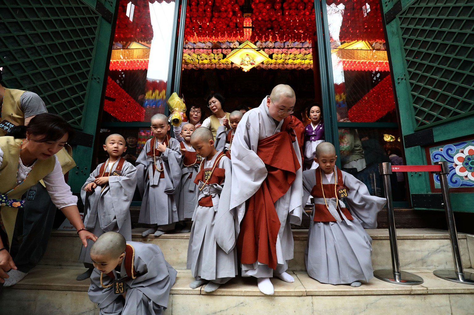 Children attend the Children Becoming Buddhist Monks ceremony at a Chogye temple on May 2 in Seoul, South Korea. Children got their hair shaved by monks to celebrate the upcoming birthday of Buddha.  Chung Sung-Jun/Getty Images
