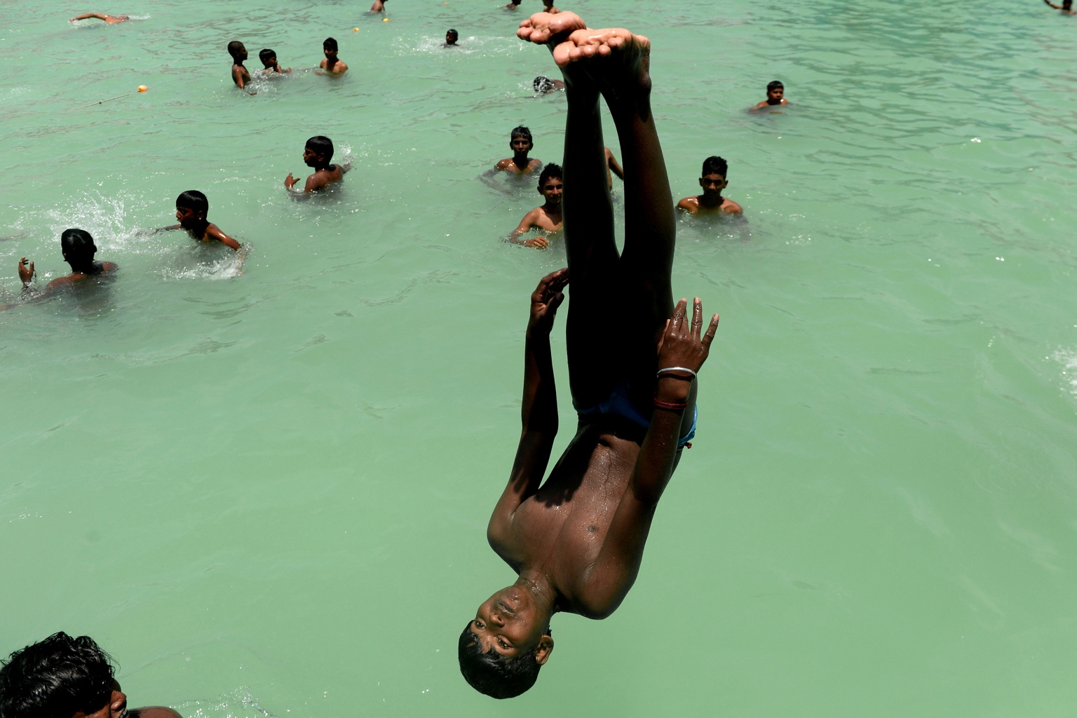Indian youth play in a swimming pool during a hot day in Chennai on May 9. ARUN SANKAR/AFP/Getty Images