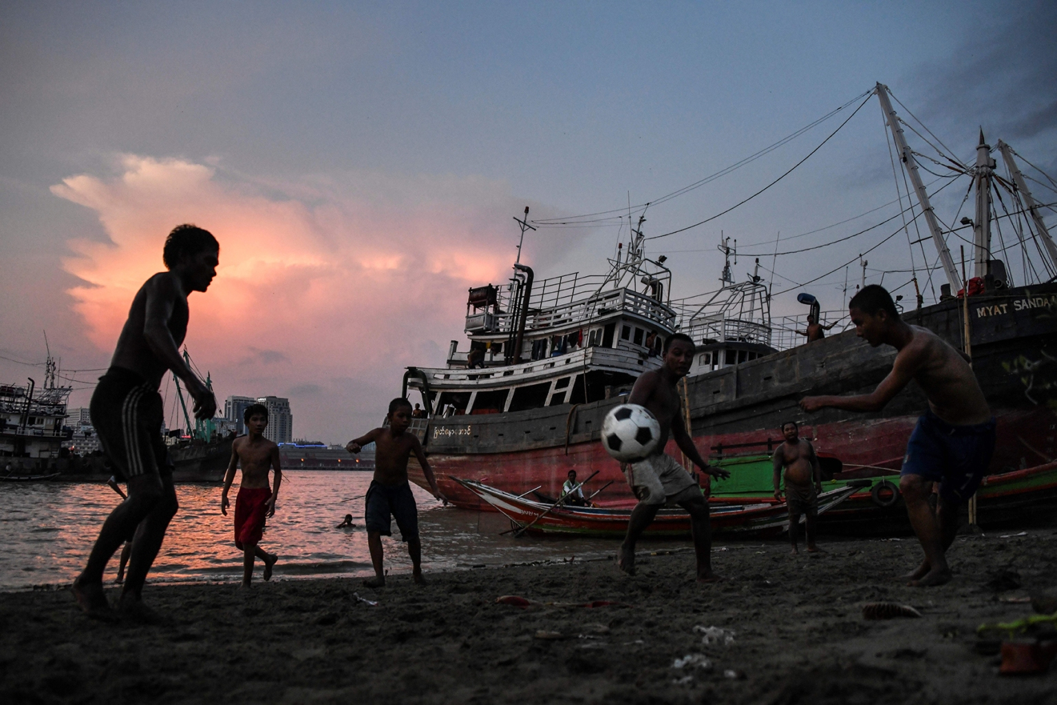 Myanmar youth play soccer on the bank of the Yangon River on May 21. YE AUNG THU/AFP/Getty Images