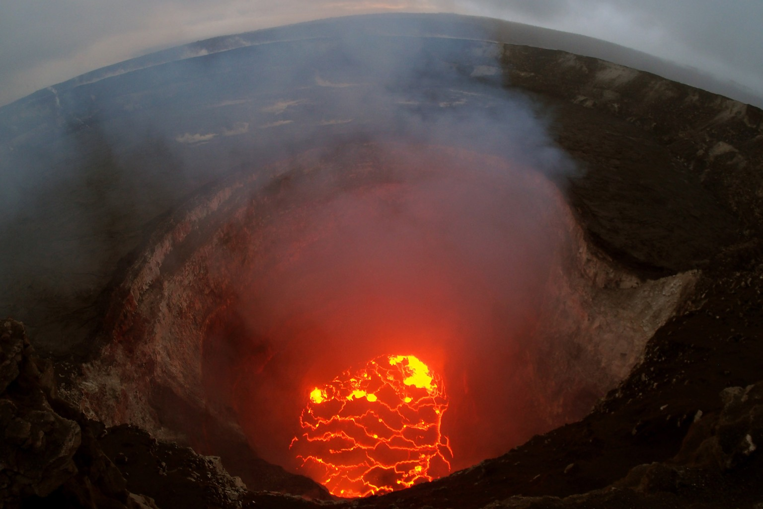A U.S. Geological Survey photo shows the lava lake from Hawaii's erupted Kilauea volcano on May 6 near Pahoa. Hawaii's governor warned May 11 that more evacuations might be needed after new forecasts that more eruptions could hurl large rocks up to half a mile. U.S. Geological Survey via Getty Images