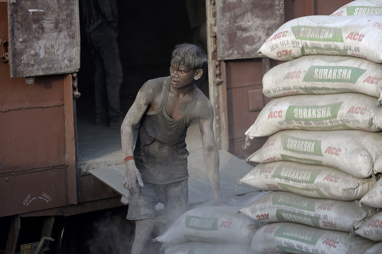 An Indian laborer pauses as he unloads sacks of cement from a goods train at a warehouse in Jalandhar on April 30 ahead of International Labor Day. SHAMMI MEHRA/AFP/Getty Images