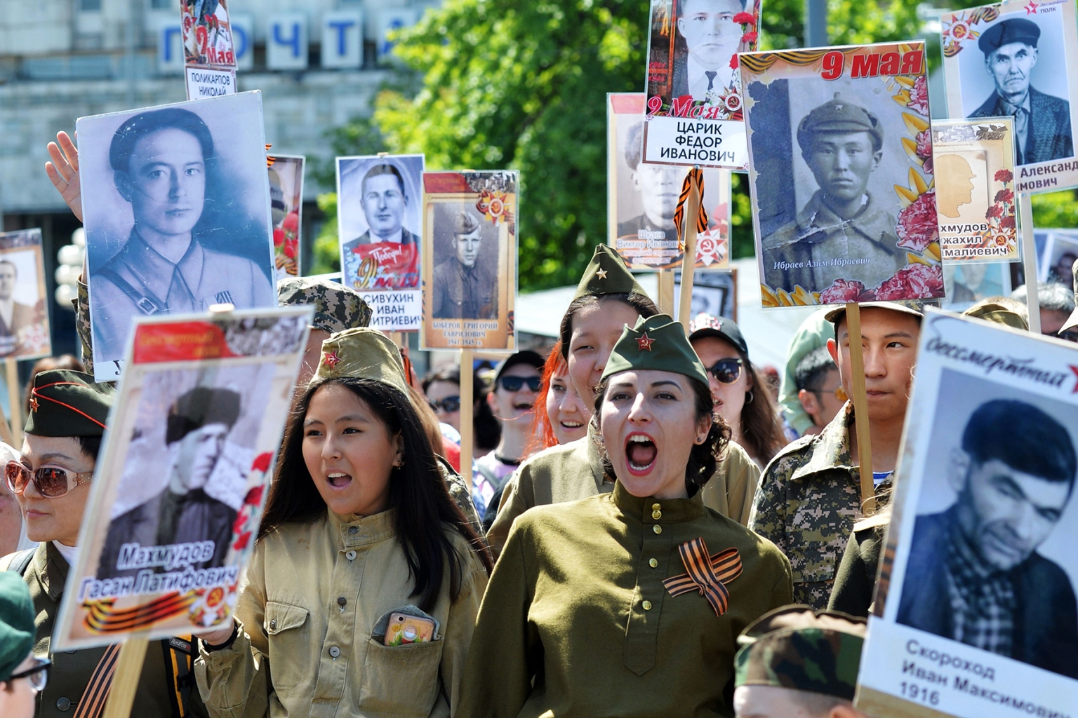 People carry portraits of World War II soldiers during the Immortal Regiment march in Bishkek, Kyrgyzstan, on May 9. Kyrgyzstan and other ex-Soviet republics marked the 73rd anniversary of the Soviet Union's victory over Nazi Germany. VYACHESLAV OSELEDKO/AFP/Getty Images