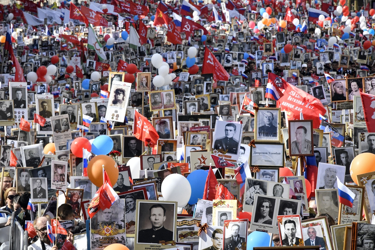 Tens of thousands of people gather in downtown Moscow holding portraits of their relatives and World War II soldiers during the Immortal Regiment march there on May 9. The portraits show some of the 27 million Soviet soldiers and citizens estimated to have died in the war. ALEXANDER NEMENOV/AFP/Getty Images