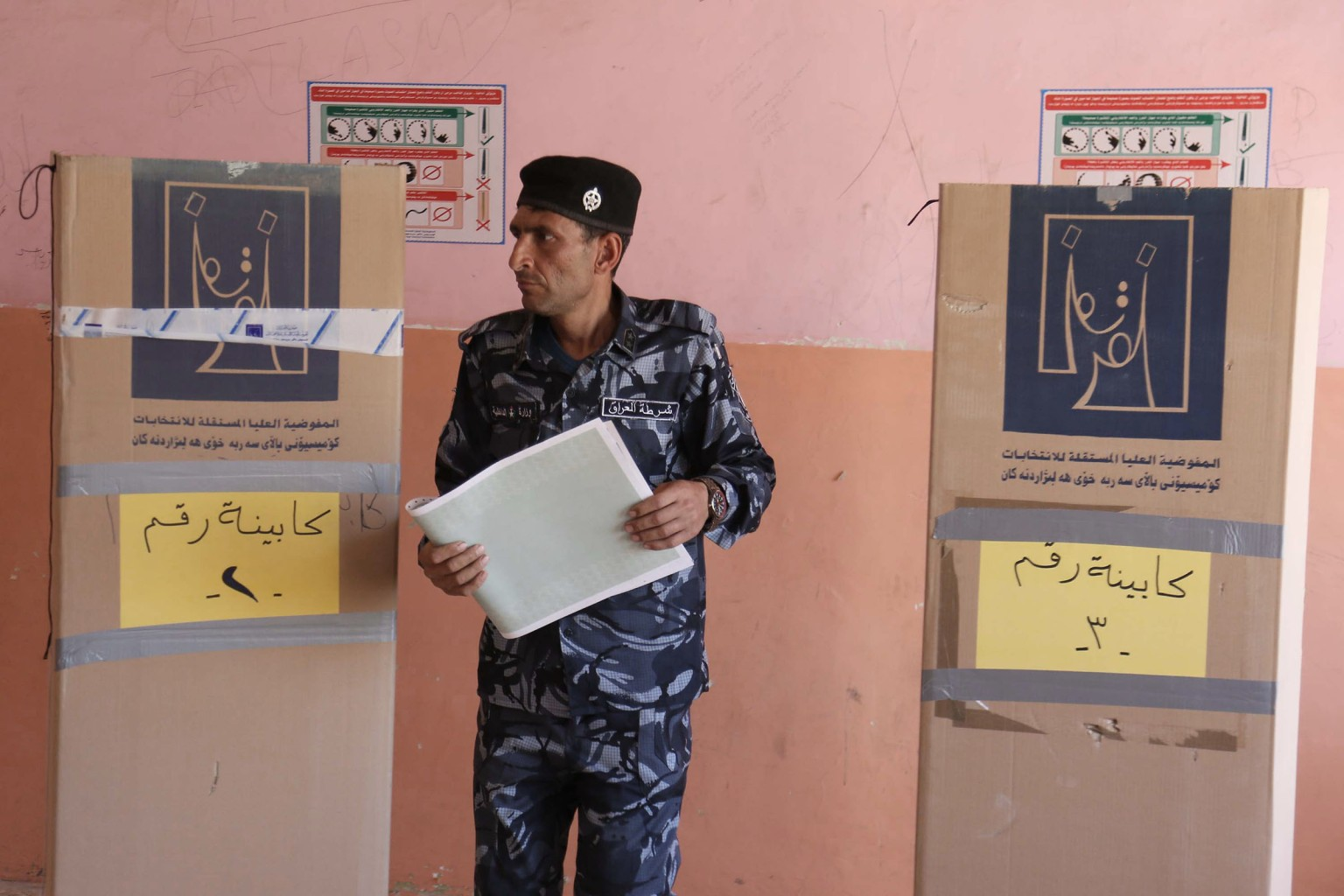 A member of the Iraqi security forces votes at a polling station in Karbala on May 10 ahead of parliamentary elections on May 12. MOHAMMED SAWAF/AFP/Getty Images