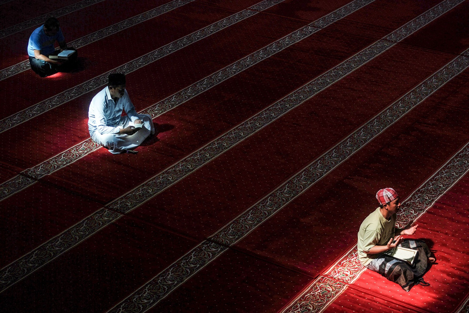 Indonesian Muslims read the Quran at a mosque in Bandung, West Java, on May 23 during the holy month of Ramadan. TIMUR MATAHARI/AFP/Getty Images