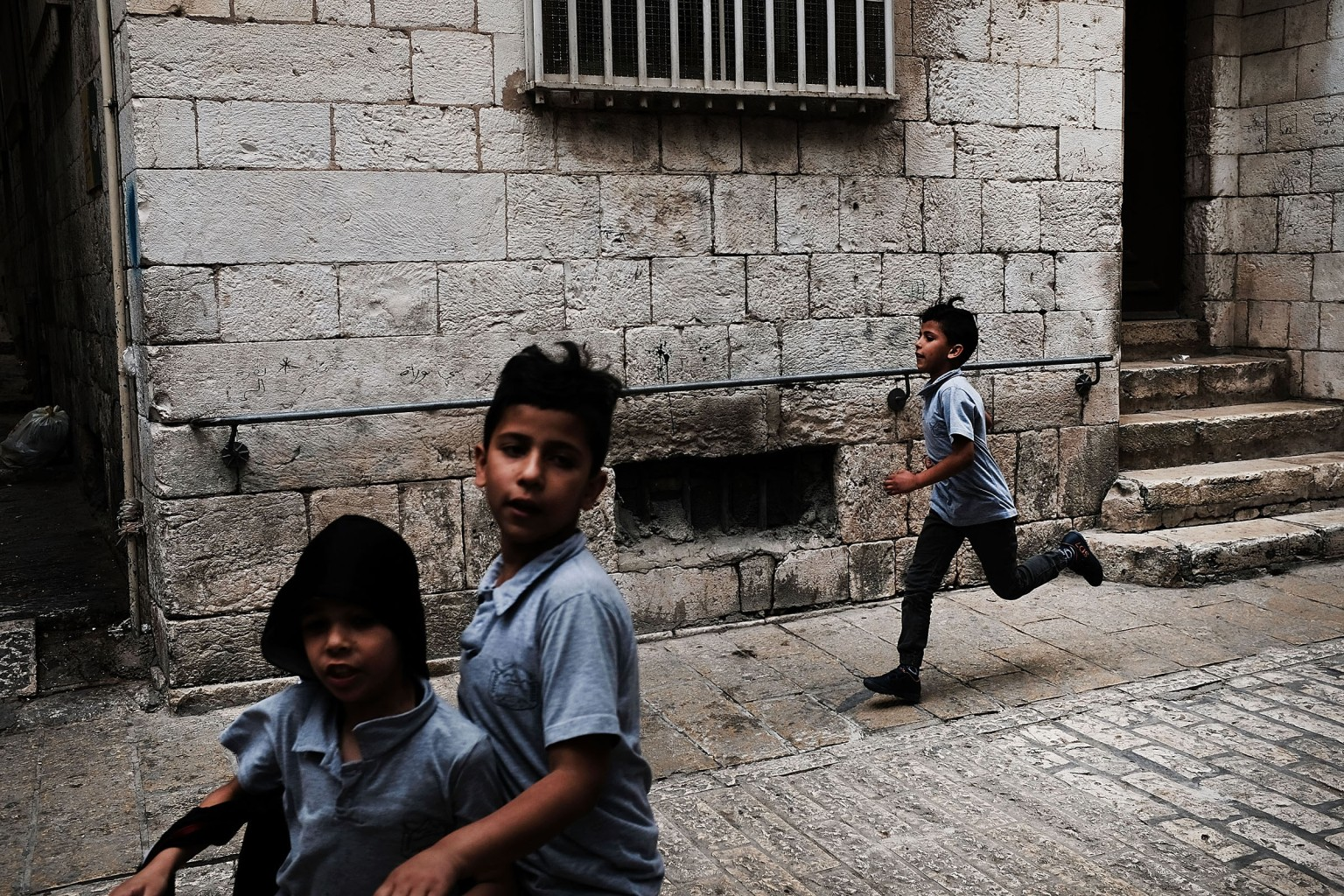 Children run through the streets of the Old City of Jerusalem on May 9. The Trump administration in December announced it would move the U.S. embassy in Israel from Tel Aviv to Jerusalem on May 14. The city's Israeli-annexed eastern sector has been long sought for a future Palestinian capital. Spencer Platt/Getty Images