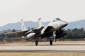 A U.S. Air Force F-15 fighter jet touching down at Gwangju Air Base in South Korea on Dec. 1, 2017. (Senior Airman Colby L. Hardin/U.S. Air Force via Getty Images)