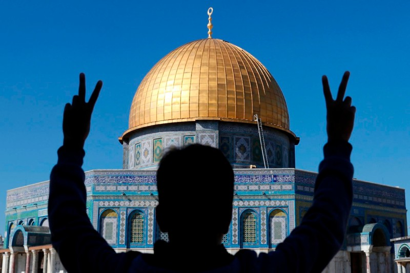 A young Palestinian in front of the Dome of the Rock at the Al-Aqsa mosque compound in Jerusalem's Old City on December 8, 2017.