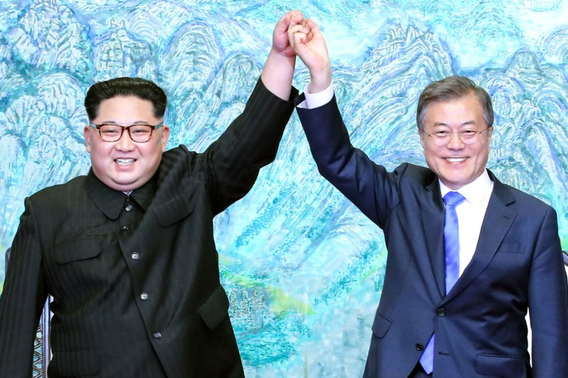 North Korean leader Kim Jong Un and South Korean President Moon Jae-in pose for photographs during the Inter-Korean Summit at the Peace House on April 27, 2018 in Panmunjom, South Korea. (Photo by Korea Summit Press Pool/Getty Images)