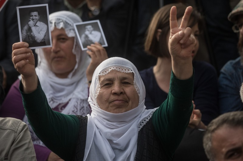 Supporters of the Pro-Kurdish Peoples' Democratic Party (HDP) shout slogans and hold pictures of HDP's imprisoned presidential candidate Selahattin Demirtas  at an election rally on May 4, 2018 in Istanbul.