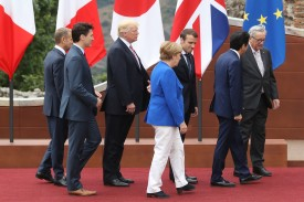 Angela Merkel, Emmanuel Macron, Donald Trump, and other leaders depart after posing for the group photo at the G7  summit on May 26, 2017 in Taormina, Italy.