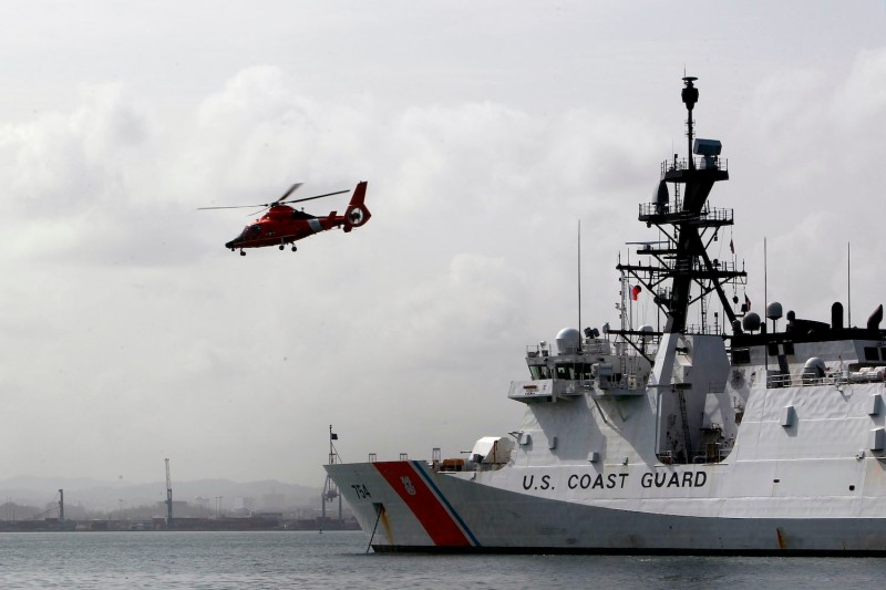 A helicopter takes off from a U.S. Coast Guard cutter one week after the passage of Hurricane Maria in San Juan, Puerto Rico, on Sept. 27, 2017. (Ricardo Arduengo/AFP/Getty Images)