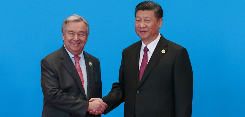 China's President Xi Jinping greets UN Secretary General Antonio Guterres at Belt and Road Forum, in Yanqi Lake, north of Beijing, on May 15, 2017.        (Roman Pilipey/AFP/Getty Images).