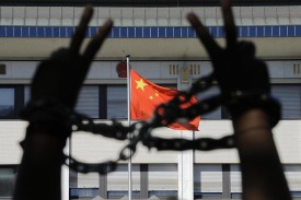 A Tibetan demonstrator flashes a V-Sign as he denounces the Olympic Games in Beijing on August 06, 2008 during a demonstration held in front of the Chinese embassy in Brussels. (John Thys/AFP/Getty Images)