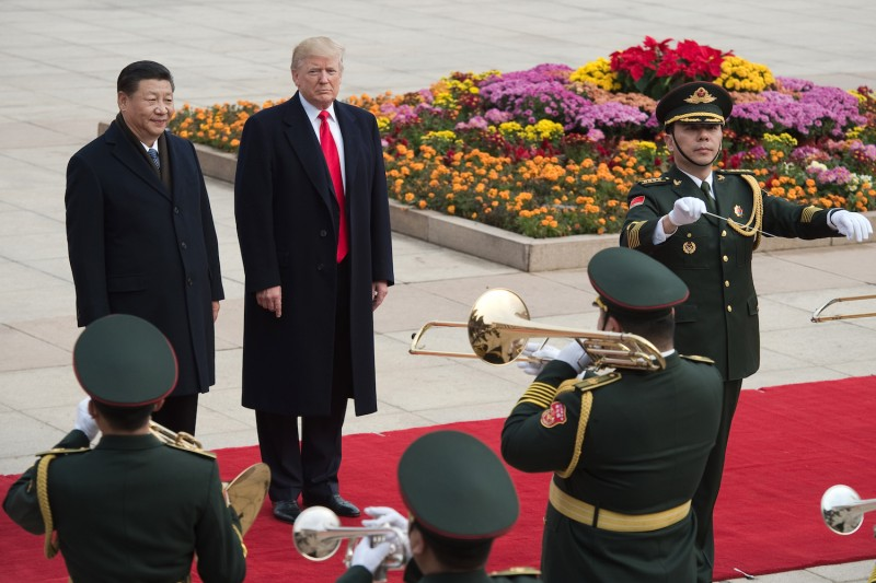 Chinese President Xi Jinping, left, and U.S. President Donald Trump, second from left, attend a welcome ceremony at the Great Hall of the People in Beijing on Nov. 9, 2017. (Nicolas Asfouri/AFP/Getty Images)