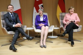 British Prime Minister Theresa May, German Chancellor Angela Merkel and French President Emmanuel Macron following a meeting on the sidelines of the European Union leaders summit in Brussels, on March 22, 2018. (LUDOVIC MARIN/AFP/Getty Images)
