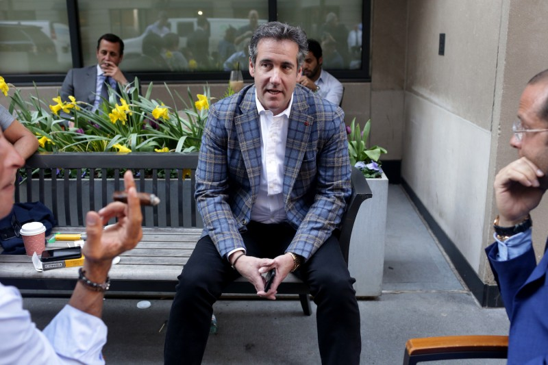 Michael Cohen, President Donald Trump's personal attorney, chats with friends near the Loews Regency hotel on Park Ave on April 13, 2018 in New York City. Photo by Yana Paskova/Getty Images