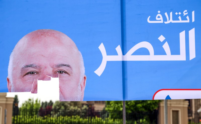 A torn up campaign poster for Iraqi Prime Minister Haider al-Abadi, for the upcoming parliamentary elections in the capital of the northern Iraqi Kurdish autonomous region Arbil. (SAFIN HAMED / AFP)