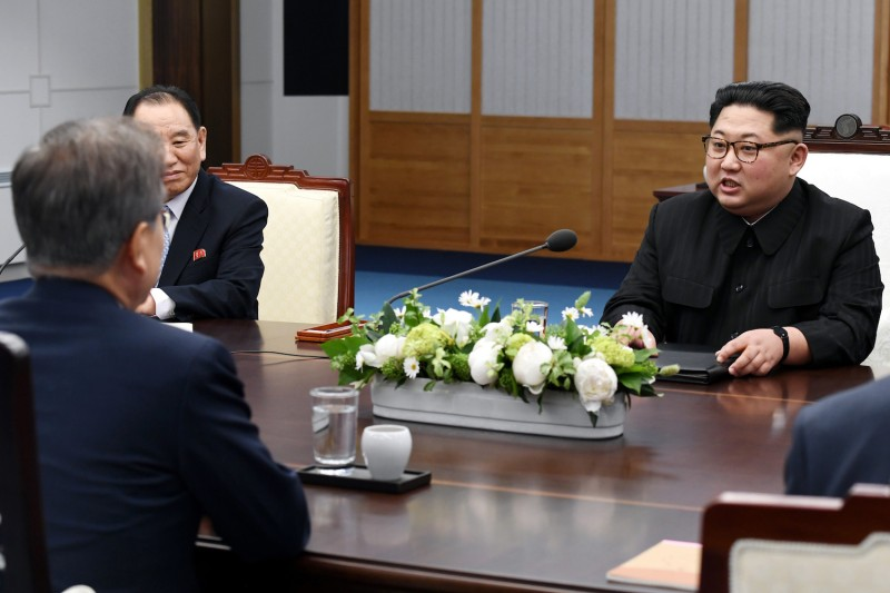 North Korean leader Kim Jong Un, right, speaks with South Korean President Moon Jae-in, left, at the Peace House in Panmunjom, South Korea, on April 27. (Korea Summit Press Pool/Getty Images)