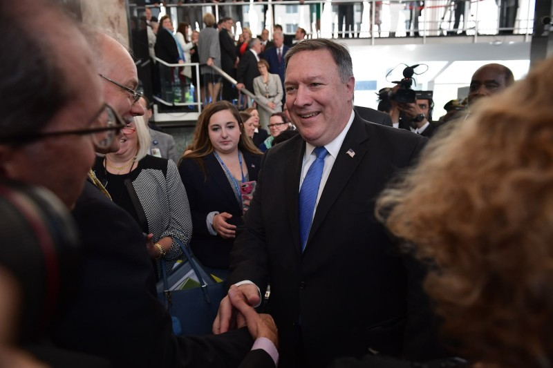U.S. Secretary of State Mike Pompeo shakes hands after delivering remarks to State Department employees in Washington on May 1. (Mandel Ngan/AFP/Getty Images)