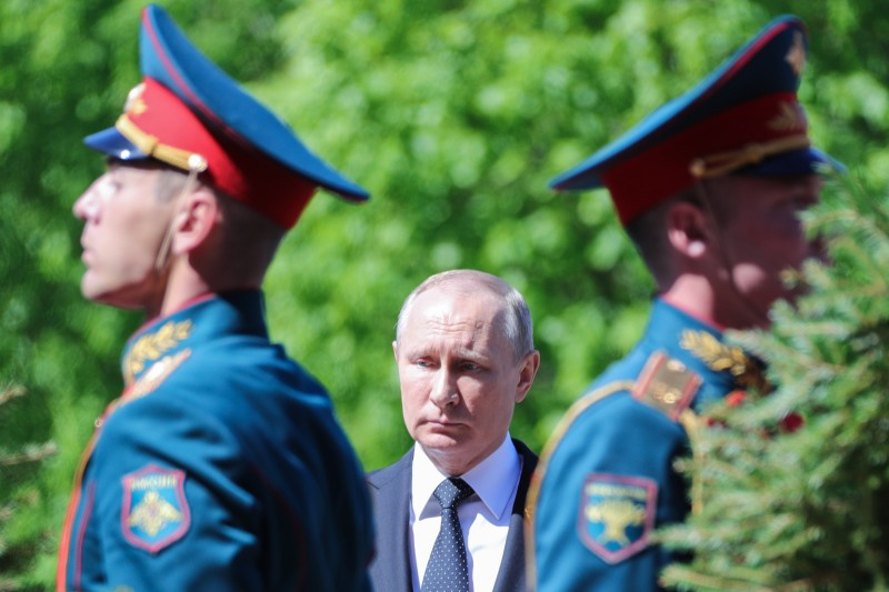Russian President Vladimir Putin attends a wreath laying ceremony marking the 73rd anniversary of the Soviet Union's victory over Nazi Germany during World War II on May 9, 2018 at the Tomb of the Unknown Soldier by the Kremlin wall in Moscow. (Photo by Mikhail KLIMENTYEV / SPUTNIK / AFP)        (Photo credit should read MIKHAIL KLIMENTYEV/AFP/Getty Images)