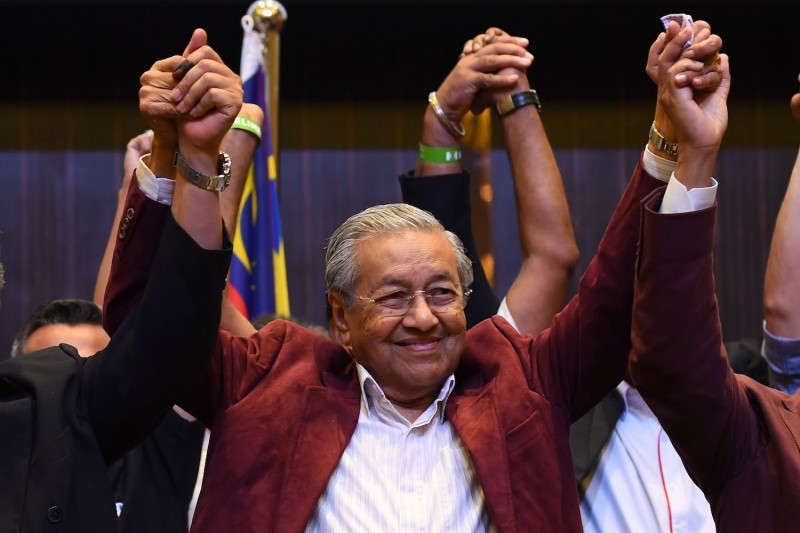 Former Malaysian prime minister and opposition candidate Mahathir Mohamad celebrates in Kuala Lumpur, Malaysia, on May 10. (Manan Vatsyayana/AFP/Getty Images)