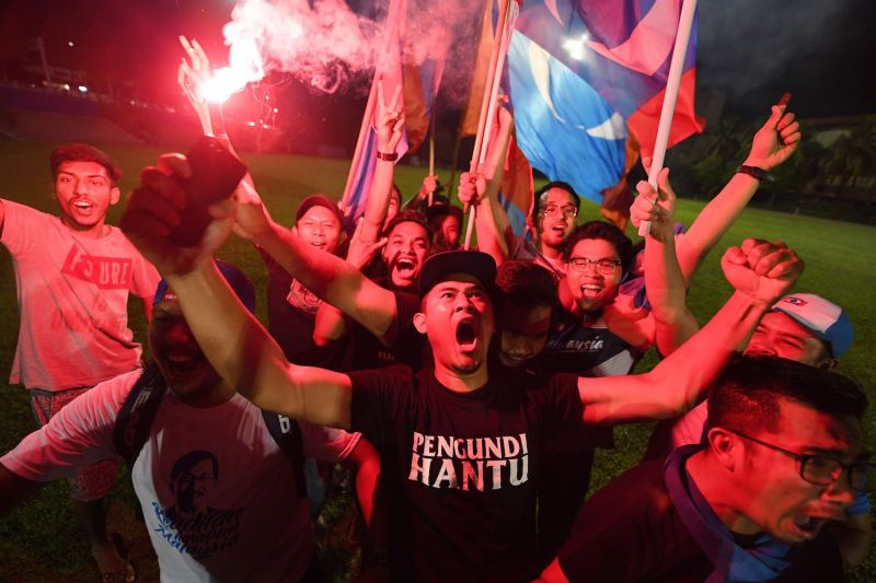 Supporters of former Malaysian prime minister and opposition candidate Mahathir Mohamad celebrate in Kuala Lumpur on May 10. (Mohd Rasfan/AFP/Getty Images)
