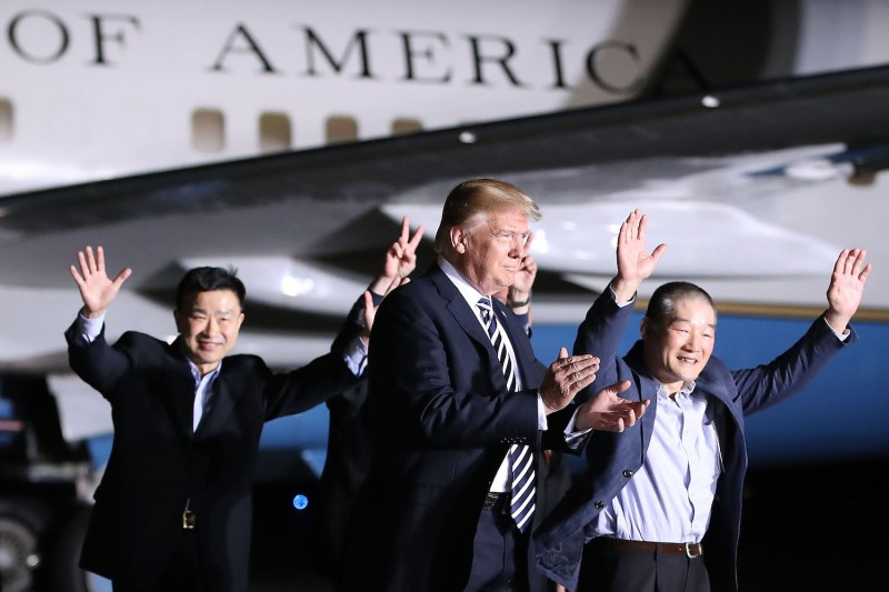 President Donald Trump walks with three Americans released from North Korea, Kim Dong Chul, Kim Hak-song and Tony Kim at Joint Base Andrews on May 9, 2018 in Maryland. Photo by Mark Wilson/Getty Images