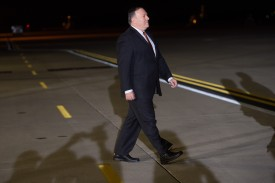 US Secretary of State Mike Pompeo walks across as the tarmac as U.S. President Donald Trump prepares to greet American detainees Kim Hak-song, Tony Kim and Kim Dong-chul that were freed by North Korea. SAUL LOEB/AFP/Getty Images