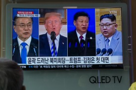 South Korean President Moon Jae-in, U.S. President Donald Trump, Chinese President Xi Jinping, and North Korean leader Kim Jong Un share a screen on South Korean television on May 11. (Kim Sue-han/AFP/Getty Images)