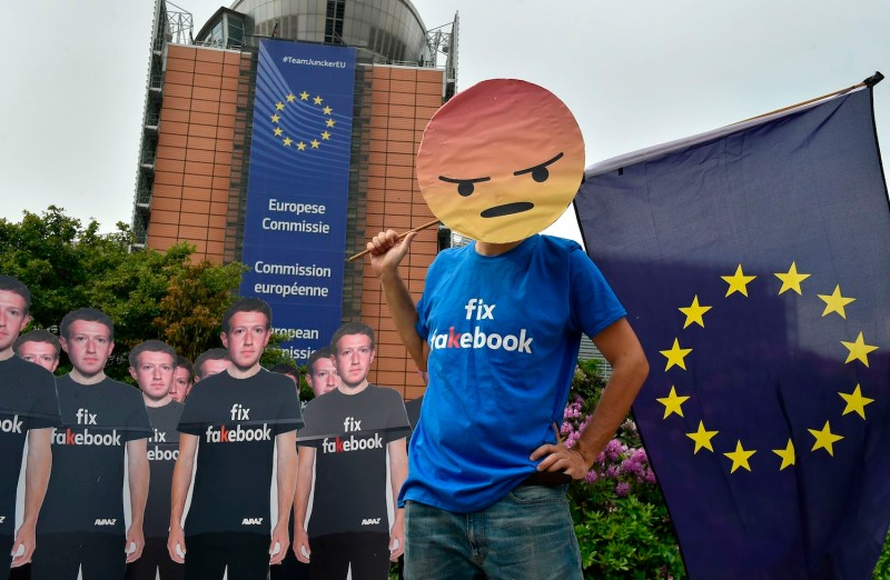 An activist protests in front of the European Union headquarters in Brussels, on May 22. (John Thys/AFP/Getty Images)