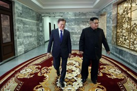 South Korean President Moon Jae-in walks with North Korean leader Kim Jong Un during their meeting on May 26, 2018 in Panmunjom, North Korea. Photo by South Korean Presidential Blue House via Getty Images
