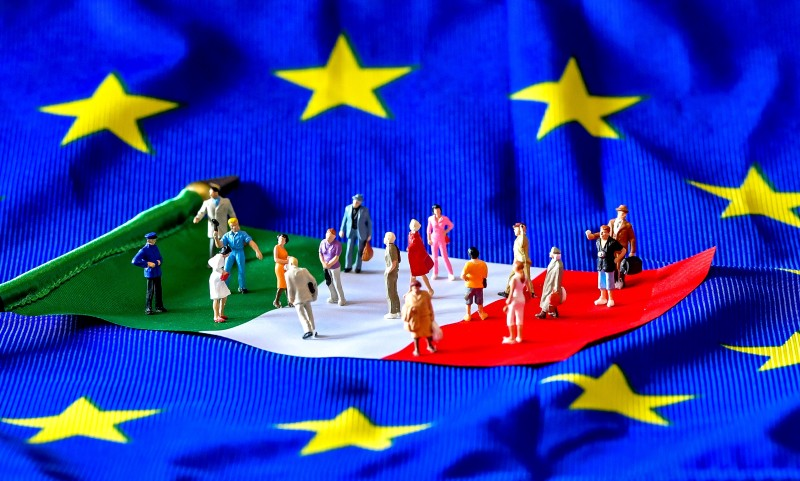 Figurines on an Italian flag, atop an EU flag. (Philippe Huguen/AFP/Getty Images)
