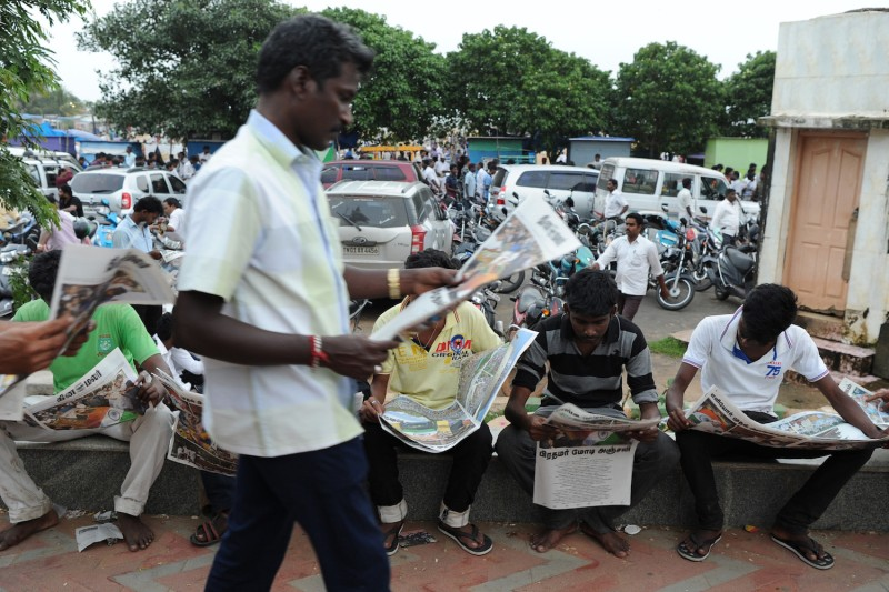 Supporters read a special edition of a local newspaper in Chennai, India, on Dec. 6, 2016. (Manjunath Kiran/AFP/Getty Images)