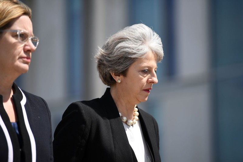 Home Secretary Amber Rudd and Britain's Prime Minister Theresa May (R) on May 23, 2017 in Manchester, England, following a suicide attack at Manchester Arena.