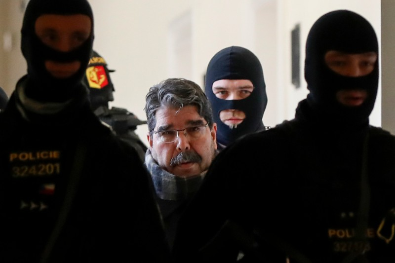 Syrian Kurdish leader Salih Muslim is escorted by Czech police to his trial at the municipal court on February 27, 2018 in Prague.
