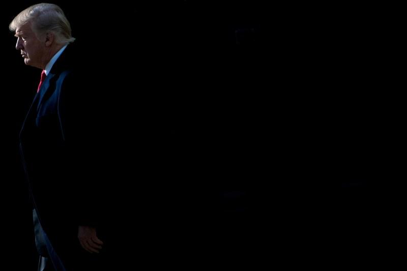 U.S. President Donald Trump walks to Marine One on December 21, 2017, in Washington, D.C. (BRENDAN SMIALOWSKI/AFP/Getty Images)