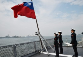 Taiwanese sailors salute the island's flag on the deck of the Panshih supply ship after taking part in annual drills, at the Tsoying naval base in Kaohsiung on Jan. 31. (Mandy Cheng/AFP/Getty Images)