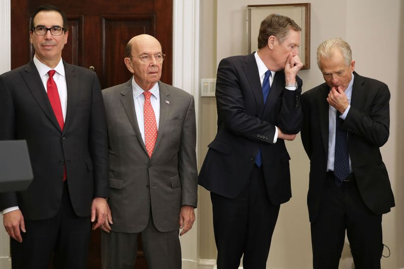 The men waging Trump's trade wars (from left): Treasury Secretary Steven Mnuchin, Commerce Secretary Wilbur Ross, U.S. Trade Representative Robert Lighthizer, and White House National Trade Council Director Peter Navarro, in the White House on March 8. (Chip Somodevilla/Getty Images)
