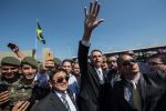 Brazilian congressman and presidential candidate, Jair Bolsonaro, waves to the crowd during a military event in Sao Paulo, Brazil on May 3, 2018.