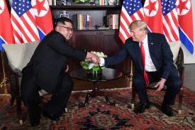 U.S. President Donald Trump, right, shakes hands with North Korean leader Kim Jong Un in Singapore on June 12. (Saul Loeb/AFP/Getty Images)